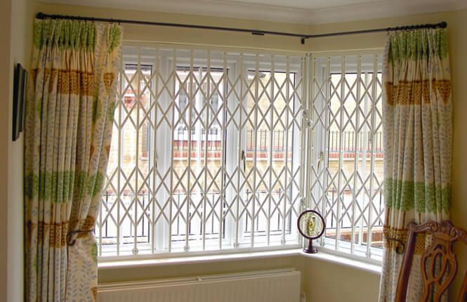 RSG1000 retractable security grilles on bay window of residential home in Kent.