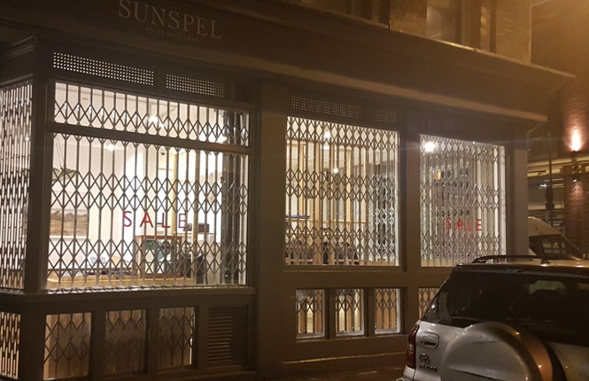 RSG1000 folding security window grilles fitted to a posh clothing shop in Redchurch St, Central London.