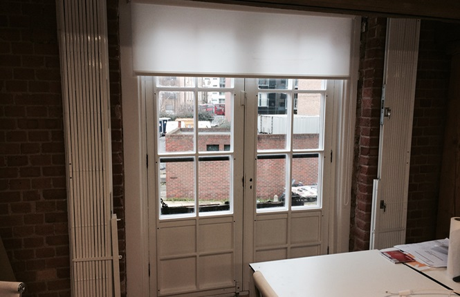 RSG1000 retractable patio door grilles securing an office in London.