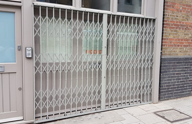 RSG1000 high security retractable grilles securing external front of offices near Waterloo.