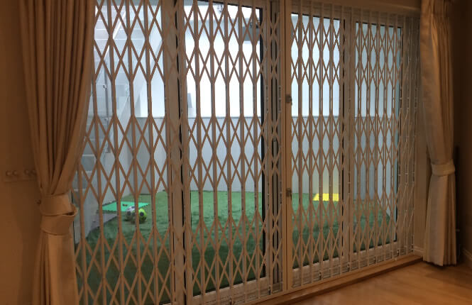 RSG1000 retractable security grille, closed and securing a patio door of a house in Hammersmith.