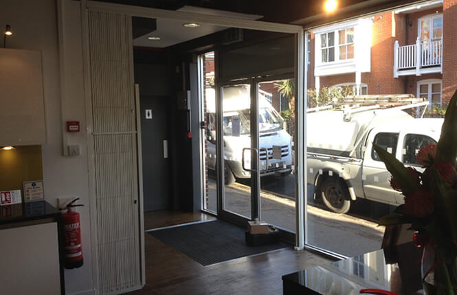 RSG1000 retractable security grille, opened during working hours in London.