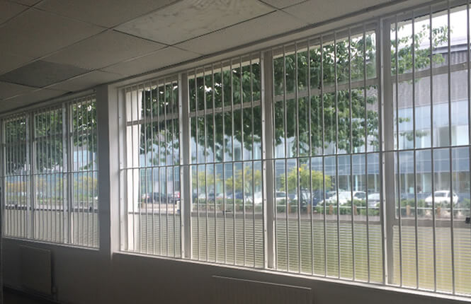 RSG2000 security bars fitted onto windows of a retail warehouse in North London.