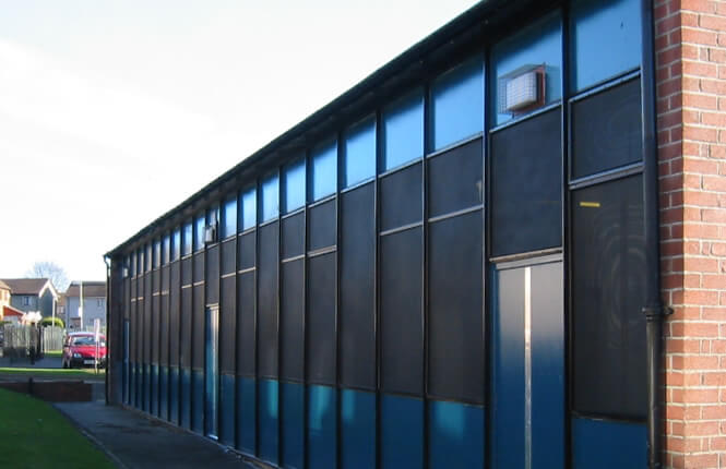 RSG2200 window security shields on industrial unit in Hackney.