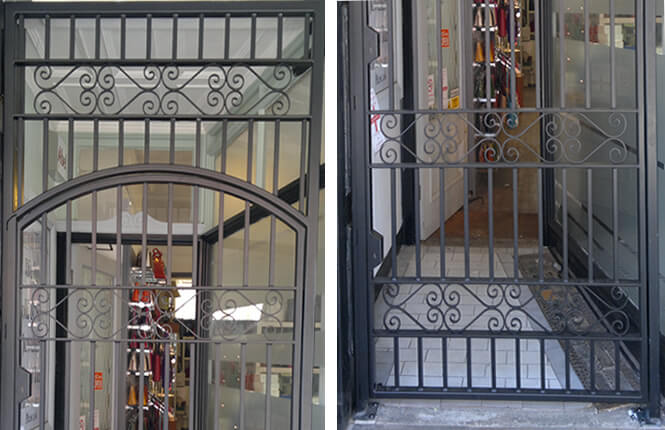 RSG3000 wrought iron gate and overhead panel with scrolls on shop entrance in London city.