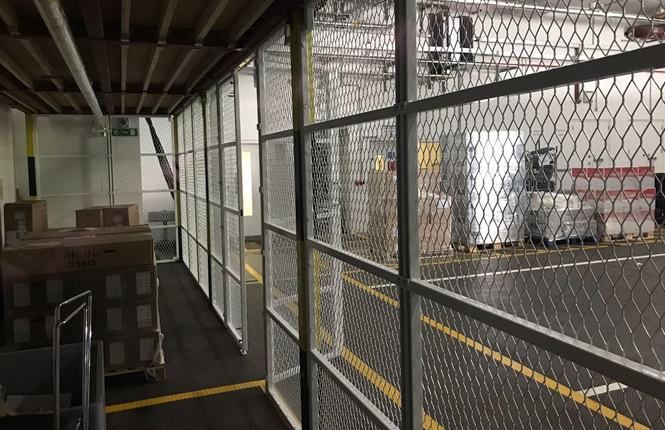 RSG4000 security enclosures providing a security area within warehouse.