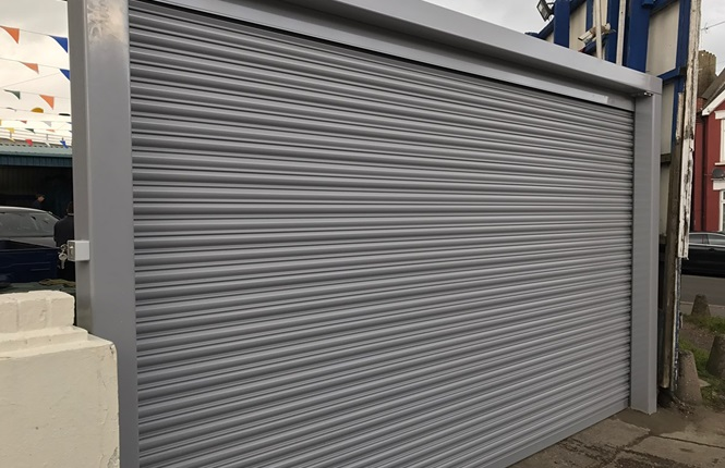 RSG5000 solid steel security shutter with Goal Post fitted to a carwash company in Harrow.