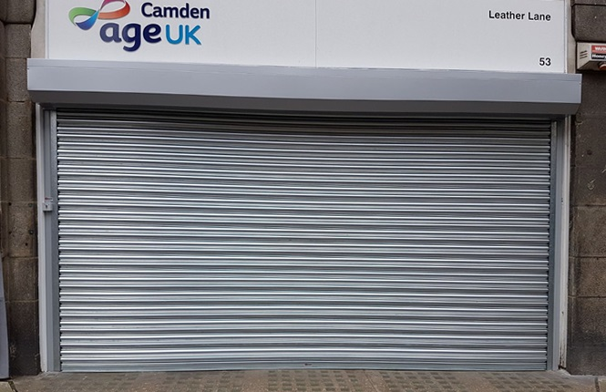 RSG5000 commercial shutter fitted to the entrance of Age UK charity shop in Holborn, Central London.