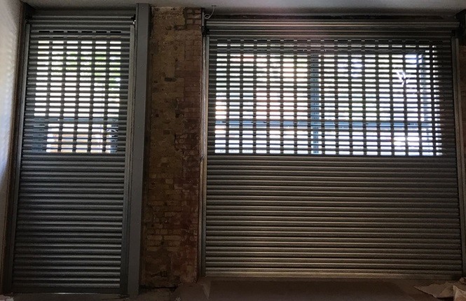 RSG5600 commercial security roller shutters providing security to office fronts near Old Street in Central London.