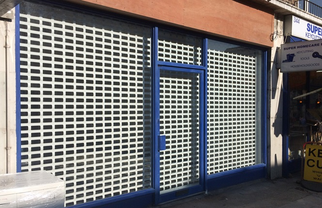 RSG5600 punched security roller shutter installed on a new retail shop in Hackney.