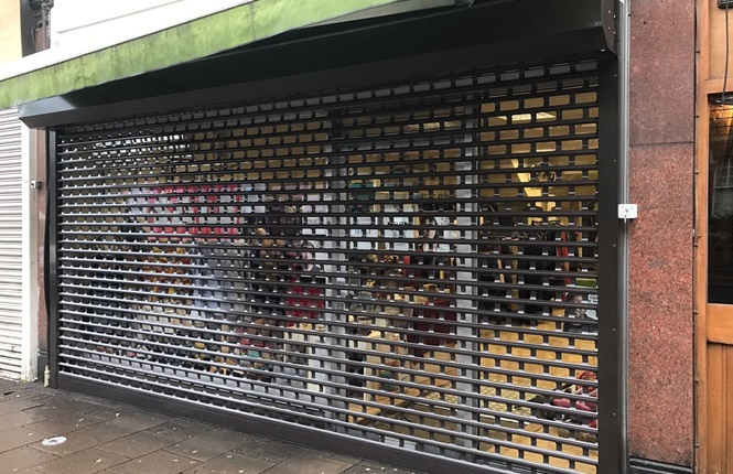RSG5600 punched roller shutter securing London British Charity.