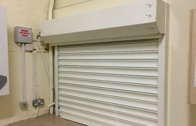 RSG5700 opened fire shutter fitted to the kitchen area inside a London commercial outlet.