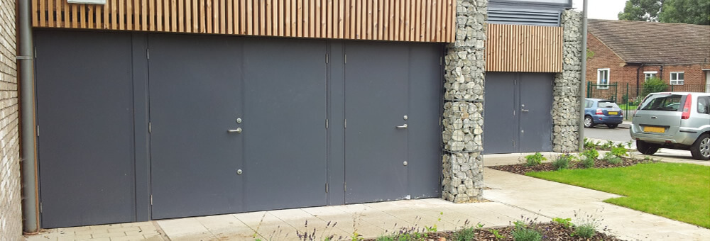 Entry steel security doors fitted at the rear of new commercial units in Surrey