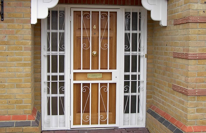 RSG3000 security door gate with side panels and scrolls.