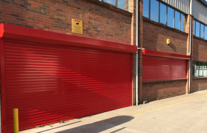 RSG5600 commercial security roller shutters on DHL warehouse in Essex.