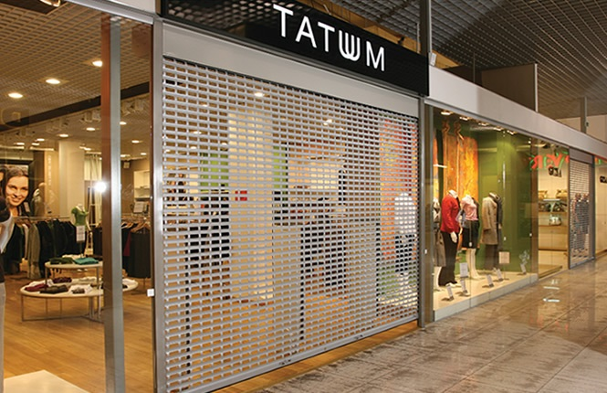RSG5600 shop front shutter securing retail outlet Tatum in Brent Cross shopping centre.