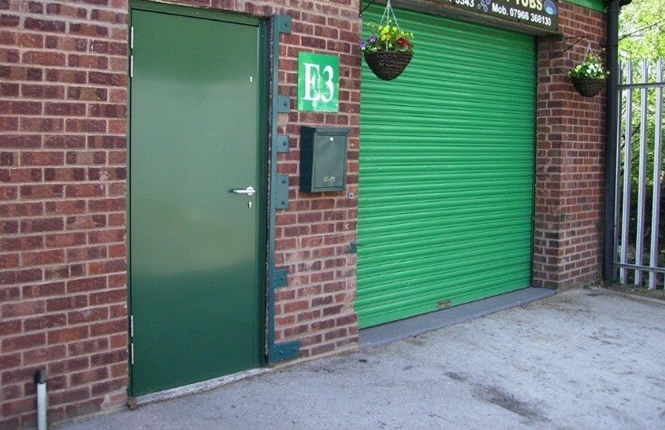RSG8000 industrial security door on a commercial shop entrance.
