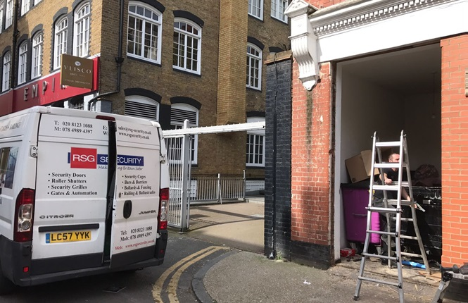 Our installation team working on the fitting of our RSG8200 fully louvred bin store door on residential apartments near Liverpool St Station.